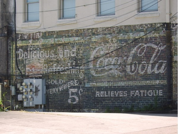 A landmark of the Depot District is the restored coke sign on the back of the wisteria building